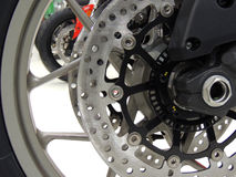 Brake disc on the front wheel of sport motorcycle at moto shop stock photo Royalty Free Stock Photography