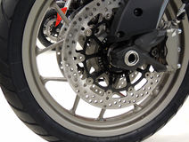 Brake disc on the front wheel of sport motorcycle at moto shop stock photo Stock Photos