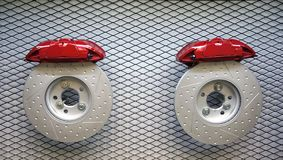 Brake disc and red caliper from a racing car royalty free stock photo