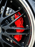 Brake Disc and Red Calliper Royalty Free Stock Images