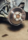 Brake discs on the machine with the removed wheels on the jacks Royalty Free Stock Image