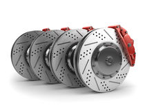Brake Discs and Red Calipers from a Racing Car Royalty Free Stock Images