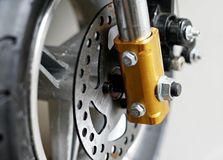 Brake disk on mini motorbike. Closeup of front brake disk on mini motorbike Stock Photo