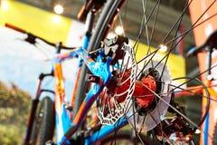 Brake disk of rear wheel sport mountain bike in shop Royalty Free Stock Photography