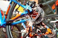 Brake disk of rear wheel sport mountain bike in shop Stock Photography