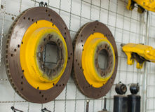 brake disks for car and rusty spare parts Royalty Free Stock Photography