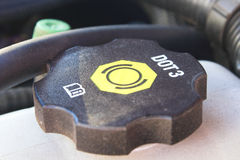 Brake fluid cap. An auto brake fluid reservoir cap Royalty Free Stock Photo