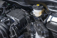 Brake Fluid Reservoir Under the Hood of a Car Stock Photo