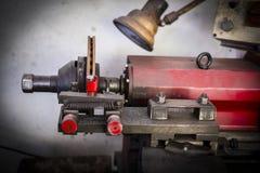 Brake lathe tool polishing disc brakes of cars working. Automatic royalty free stock images
