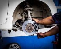 Brake lathe tool polishing disc brakes of cars working. Automatic royalty free stock photo