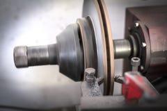 Brake lathe tool polishing disc brakes of cars working. Automatic stock photo