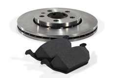 Brake pads and brake disc. Two brake pads and one new brake disc for the car Royalty Free Stock Image