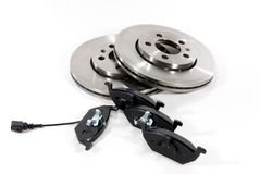 Brake pads and brake discs. Four brake pads and two new brake discs for the car Stock Photo