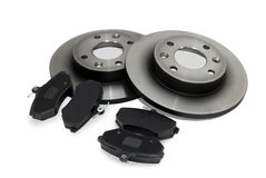 Brake pads and brake discs. Four brake pads and two new brake discs for the car Stock Image