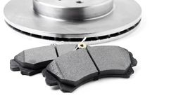 Brake pads and brake discs on white background. Auto parts.  Royalty Free Stock Images