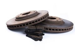 Brake pads and brake discs on white background royalty free stock images