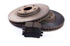 Brake pads and brake discs on white background royalty free stock photos