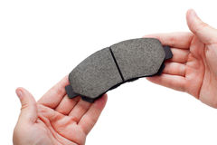 Brake pads on hand. Stock Images