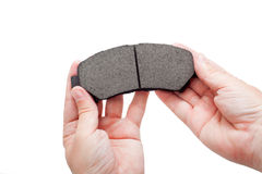 Brake pads on hand. Brake pads of the car on a white background, on engineer hand,  isolated image nobody Stock Photos