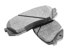 Brake pads isolated on white background. Auto parts. Brake pads isolated on white. Braking pads. Car part. Car detailing. Spare pa. Rts. Black and white royalty free stock image
