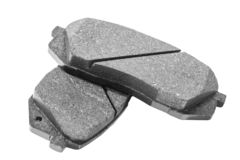 Brake pads isolated on white background. Auto parts. Brake pads isolated on white. Braking pads. Car part. Car detailing. Spare pa. Rts stock photo
