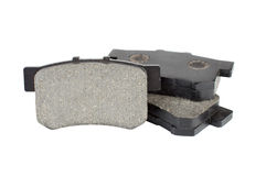 Brake pads isolated on white background. Car spare pars for brakes service Royalty Free Stock Photos