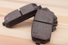 Brake pads on a woden workbench with tools Royalty Free Stock Photography