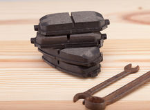 Brake pads on a woden workbench with tools Stock Photography