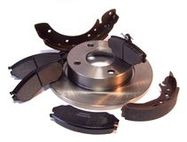 Brake parts. A composition of car brake parts - pads, disc and shoes Stock Image
