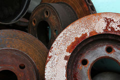 Brake Parts - Auto Service. Brake rotors removed from service. Safety component royalty free stock photo