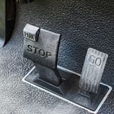 Brake pedal and accelerator. Brake pedal and accelerator of golf cart Stock Photos