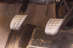 Brake pedal and accelerator. In a car Stock Photography