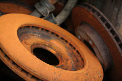 Brake Rotors, Car Parts. Brake rotors removed from service in a mechanics garage. Focus on near edge of rotor royalty free stock photo