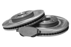 Brake shoe and discs. Brake pad and discs with shallow depth of field on a white background Royalty Free Stock Images