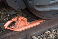 Brake shoe in front of freight car Stock Images