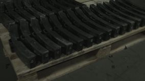 Brake shoes for the train. Details in the production shop of the plant, on the pallet. Without color correction stock footage