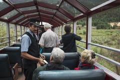 Brakeman takes tickes on Durango and Silverton Narrow Gauge Railroad featuring Steam Engine Train ride, Colorado, USA Royalty Free Stock Image
