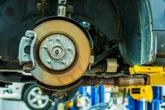 Brakes Repair Auto Service. Modern Car Brakes Servicing. Car Maintenance. Auto Service Royalty Free Stock Photography