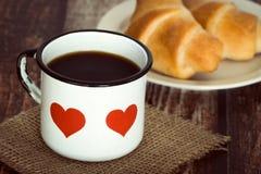 Brakfast coffee in an old enamel mug Stock Photos