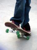 Braking. Young skate boarder demonstrating proper braking technique Royalty Free Stock Photos