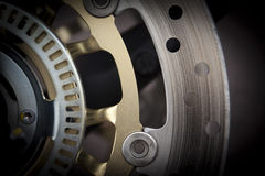 Braking discs. A macro shot of a brake disc from a motor cycle Royalty Free Stock Images