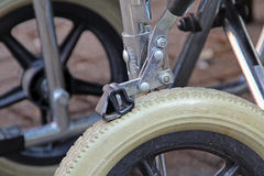 Braking mechanism on wheelchair Stock Images