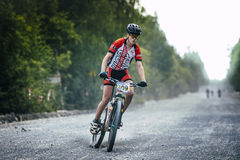 Braking mountain bikers of the gravel road Royalty Free Stock Photos
