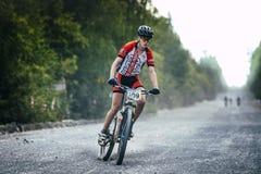 Braking mountain bikers of the gravel road Royalty Free Stock Photos