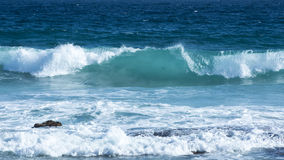 Breaking Wave with white vapour Royalty Free Stock Image