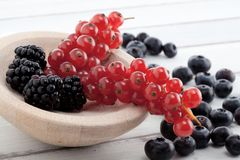 Brambleberries, currants and blueberries on table Royalty Free Stock Photo