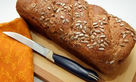 Bran bread, sprinkled with seeds and cooked at home Stock Images