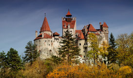 Bran Castle in autumn landscape Stock Images