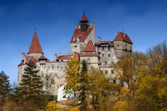 Bran Castle in autumn landscape Stock Photo