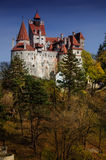 Bran Castle in autumn landscape Stock Photos